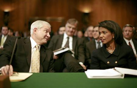 Secretary of State Condoleezza Rice (R) and Defense Secretary Robert Gates talk after arriving to testify at a Senate Appropriations Committee hearing on the president's funding requests for Iraq and Afghanistan, on Capitol Hill February 27, 2007. REUTERS/Jason Reed