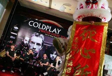 Members of british rock band Coldplay attend a news conference in Hong Kong July 13, 2006. EMI Group Plc, the world's third largest music company and home to Coldplay, has rejected a 2.1-billion-pound ($4.1 billion) cash takeover proposal from Warner Music Group, saying on Friday it was not in the best interests of its shareholders. REUTERS/Paul Yeung