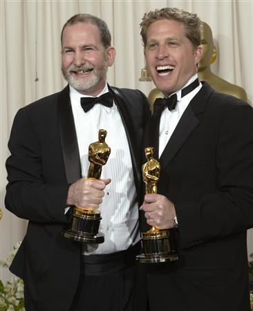 Bill Guttentag and Robert David Port (R) at the 75th Annual Academy Awards at the Kodak Theatre in Hollywood, California March 23, 2003 file photo. Independent distributor ThinkFilm has acquired North American rights to ''Nanking,'' directed by Guttentag and Dan Sturman, a documentary chronicling Japan's infamous 1937 invasion of the Chinese city. REUTERS/Andy Clark