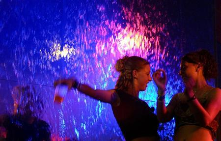 Two U.S. spring breakers dance at a nightclub in Mexico's prime tourist resort Cancun March 15, 2006. Researchers reported on Sunday that a hormone produced by the body in response to stress that normally serves to calm adults and younger children instead increases anxiety in adolescents. REUTERS/Victor Ruiz