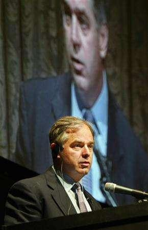 File photo shows Ripplewood Holdings CEO Timothy Collins speaking to reporters at a news conference in Tokyo announcing that Japanese Internet service provider Softbank Corp would buy Japan Telecom Co from his New York-based Ripplewood, May 27, 2004. REUTERS/Eriko Sugita