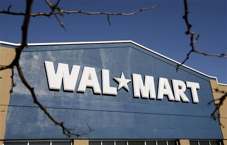 A file photo of a Wal-Mart store sign as seen in Niles, Illinois November 24, 2006. Frustrated by a bruising, and so far unsuccessful battle to open its first discount store in New York City, Wal-Mart chief executive said, ''I don't care if we are ever here.'' REUTERS/John Gress
