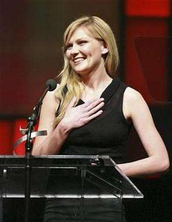 Kirsten Dunst addresses the audience after being honored as the Female Star of the Year at ShoWest convention at the Paris Hotel in Las Vegas on March 15, 2007. With about 21 years of show business experience on her resume, actress Kirsten Dunst says sex scenes don't faze her, and she's hoping to play Blondie singer Debbie Harry in a new film. REUTERS/David Allio