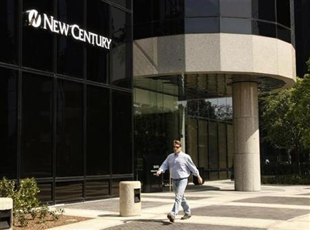 A man walks past the entrance to the corporate headquarters of New Century Financial Corporation in Irvine,California March 15, 2007. New Century Financial Corp. on Monday filed for Chapter 11 bankruptcy protection in the biggest collapse of a mortgage lender in the U.S. housing downturn. REUTERS/Fred Prouser