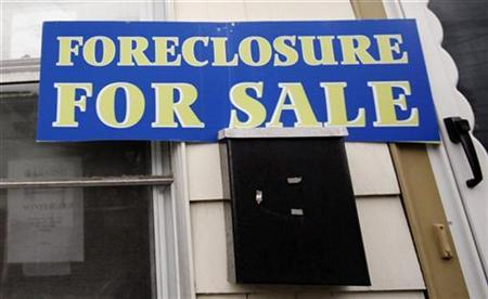A sign reading 'Foreclosure For Sale' is posted on a house in the Boston suburb of Dedham, Massachusetts, March 15, 2007. For years, political leaders touted rising homeownership rates as a sign the ''American Dream'' was being fulfilled but more than a million looming foreclosures have called the dream into question. REUTERS/Brian Snyder