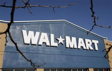 A Wal-Mart store sign as seen in Niles, Illinois, November 24, 2006. The Wal-Mart Stores Inc. worker fired last month for intercepting a reporter's phone calls says he was part of a larger, sophisticated surveillance operation that included snooping not only on employees, but also on critics, stockholders and the consulting firm McKinsey & Co., The Wall Street Journal reported. REUTERS/John Gress