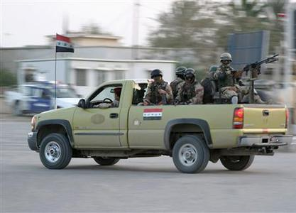 An Iraqi military vehicle patrols a road in Diwaniya, 180 km (112 miles) south of Baghdad, April 6, 2007. Iraqi and U.S. troops on Friday moved into the southern city of Diwaniya, a stronghold of Shi'ite militia loyal to anti-American cleric Moqtada al-Sadr, in an operation to curb the militia's increasing influence. REUTERS/Imad al-Khozai