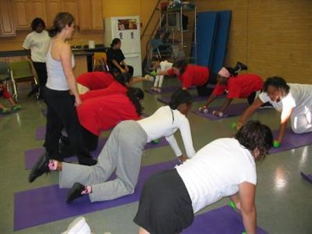 Students at Trenton Central High work out with an experienced certified fitness trainer in an undated photo. Overweight people have higher risks of heart disease, diabetes and some cancer, and obesity makes the risks much more imminent. REUTERS/Women's Heart Foundation/Handout