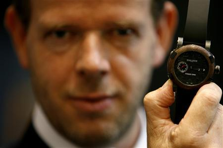 Swiss watchmaker Romain Jerome CEO, Yvan Arpa, shows the ''Titanic DNA'' watch during the opening day of Baselworld in Basel, April 12, 2007. REUTERS/Christian Hartmann
