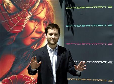 Tobey Maguire gestures during a photocall in Madrid, July 13, 2004. Even superheroes get the blues, as ''Spider-Man'' discovers in this latest sequel during which he confronts a mutant made of sand, a vengeful former friend and, ultimately, himself.REUTERS/Sergio Perez