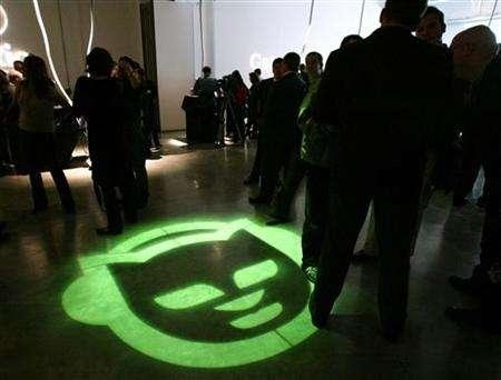 The Napster ''Cat'' logo is shown on the floor at a launch event for the new Napster online music service in New York City, in this October 9, 2003 file photo. Warner Music Group, the world's fourth largest music company, and Bertelsmann AG, the German media conglomerate, said on Tuesday they have agreed to settle claims related to Bertelsmann's relationship with the original Napster in 2000 and 2001. REUTERS/Jeff Christensen