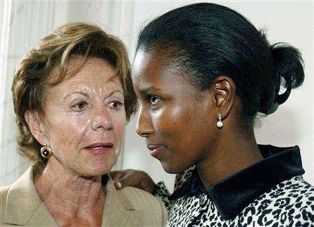 Ayaan Hirsi Ali (R), a Somali-born former Dutch politician, speaks with EU Competition Commissioner Neelie Kroes during her farewell party in the Houses of Parliament in The Hague in this August 31, 2006 file photo. For three years Somali-born Ayaan Hirsi Ali galvanised Dutch society with a frank account of her traumatic past and her conviction that Islam is a violent, misogynous religion. To match feature MUSLIMWOMEN EUROPE/DUTCH REUTERS/Toussaint Kluiters/Files