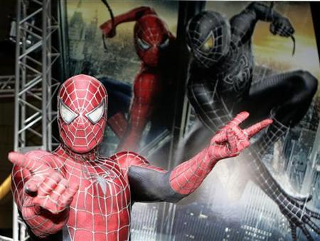 A man dressed as Spider-Man poses for photographers at the ''Spider-Man 3'' world premiere event in Tokyo April 16, 2007. Sony Pictures Entertainment on Tuesday said DVDs in China that were reported to be pirated copies of widely anticipated ''Spider-Man 3'' are in fact copies of its predecessor, ''Spider-Man 2.'' REUTERS/Yuriko Nakao