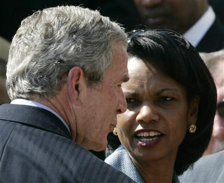 Secretary of State Condoleezza Rice speaks to President Bush during a ceremony honoring the Super Bowl Champion Indianapolis Colts at the White House, April 23, 2007. REUTERS/Jim Young