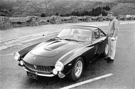 Steve McQueen stands next to his 1963 Ferrari 250 GT Berlinetta Lusso in an undated file photo released to Reuters on April 27, 2007. A 1963 Ferrari once owned and driven by the late film star Steve McQueen is expected to fetch between $800,000 and $1.2 million at an auction in August, Christie's said. REUTERS/William Claxton/Courtesy of Demont Photo Management, LLC/Handout