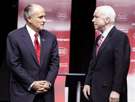 Former New York Mayor Rudy Giuliani stands with Sen. John McCain (R-AZ) at the GOP presidential candidates debate at the Ronald Reagan Presidential Library in Simi Valley, California, May 3, 2007. REUTERS/Lucy Nicholson