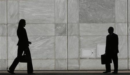 People are silhouetted at Canary Wharf business district in London May 1, 2007. Men in South Africa say they cheat instead of taking second or third wives, Americans lament that love has died in their marriages, and the Japanese believe ex-marital sex isn't adultery if they pay for it. REUTERS/Luke MacGregor
