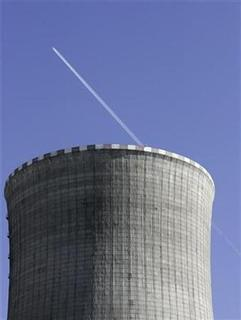 An airplane flies past the Mochovce Nuclear Power Plant cooling tower in Mochovce, Slovakia, March 15, 2007. The world nuclear power industry welcomed on Friday the tacit backing given to their technology by some of the world's top scientists and economists in the latest analysis of the climate change crisis. REUTERS/David W Cerny