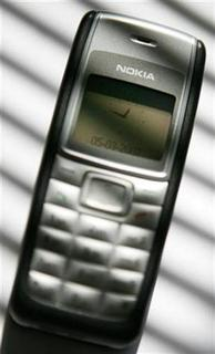 The Nokia 1100 phone is seen in this photo taken in Stockholm May 3, 2007. The company said it would roll out an initiative in which mobile phones will alert users to save energy. REUTERS/Bob Strong