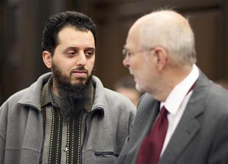 Mounir El Motassadeq (L) and his lawyer Udo Jacob are pictured prior to the trial at a court in Hamburg, northern Germany, January 8, 2007. Germany's highest court of appeal rejected a legal challenge by the Moroccan friend of the September 11, 2001 hijackers against a 15-year jail sentence for being an accessory to mass murder. REUTERS/Fabian Bimmer/Pool