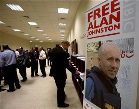 A poster of the missing BBC journalist Alan Johnston, who disappeared in Gaza on March 12, is displayed during the World Economic Forum in the King Hussein Convention Centre at the Dead Sea May 18 2007. A television cameraman held prisoner for years at the U.S. Navy base in Guantanamo Bay, Cuba, has issued an impassioned plea for the release of a fellow journalist kidnapped in Gaza. REUTERS/Ali Jarekji