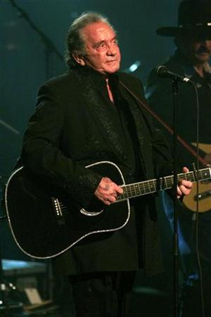 Johnny Cash performs in New York in this April 6, 1999 file photo. If you thought Cash and his wife, June Carter Cash, lived happily ever after when the final credits rolled for ''Walk the Line,'' the movie about their early romance, their son would like to set you straight. REUTERS/Jeff Christensen