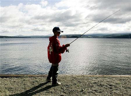 A boy fishes at Rangeley Lake in Maine in a file photo. The landmark U.S. law to fight water pollution will now apply only to bodies of water large enough for boats to use, and their adjacent wetlands, and will not automatically protect streams, the government said on Tuesday. REUTERS/Brian Snyder