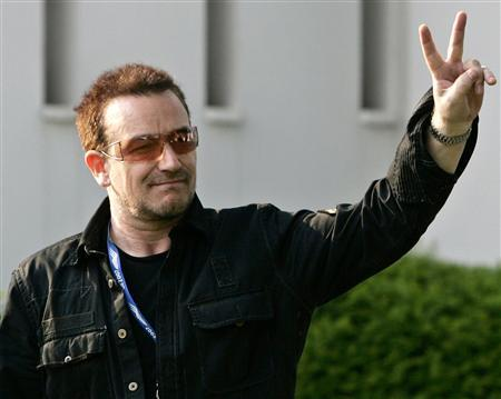 Bono, lead singer of the group U2, arrives at the G8 summit in Heiligendamm June 6, 2007. Canadian Prime Minister Stephen Harper told reporters on Thursday that meeting Bono was not a priority on the sidelines of a Group of Eight summit. REUTERS/Jim Young