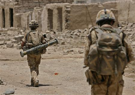British soldiers patrol the Sangin valley, in the southern province of Helmand, June 9, 2007. A NATO soldier was killed and four others wounded on Saturday in combat in southern Afghanistan, the NATO alliance's U.N.-mandated Afghan security force said. REUTERS/Ahmad Masood