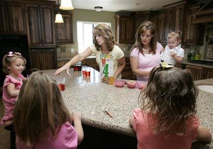 Sister-wives Valerie (L) and Vicki serve breakfast to their children in their polygamous house in Herriman, Utah, May 30, 2007. After more than a century on the fringe of America's consciousness, Mormons are riding a wave of media attention and public scrutiny -- and say they welcome the chance to set a few things straight. REUTERS/Kamil Krzaczynski