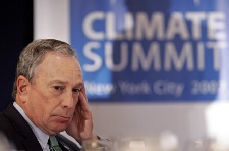New York Mayor Michael Bloomberg listens to introductions at the C40 Large Cities Climate Summit luncheon in New York May 15, 2007. REUTERS/Richard Drew/Pool