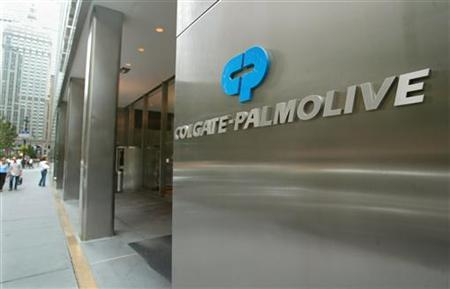 People pass the entrance of Colgate-Palmolive World headquaters in New York City, in this August 31, 2003 file photo. Colgate-Palmolive Co. said on Friday that counterfeit toothpaste falsely labeled as ''Colgate'' posed a low health risk, and the company said it was picking up the suspected fakes from small independent stores in four U.S. states. REUTERS/Jeff Christensen