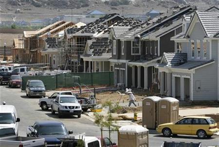 File photo of construction in Perris, California May 2, 2007. The fate of two troubled hedge funds managed by Bear Stearns was left in question after Merrill Lynch & Co. sold off assets seized from the funds and three other banks closed out their positions with them. The Bear Stearns funds once had over $20 billion of assets, but lost billions of dollars from bad bets on securities backed by subprime mortgages. REUTERS/Mark Avery