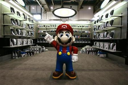 The Mario character in Nintendo video games waits for visitors at a booth being set up for 2007 International CES (Consumer Electronics Show) in Las Vegas, Nevada January 7, 2007. Doctors backed away on Sunday from a controversial proposal to designate video game addiction as a mental disorder akin to alcoholism, saying psychiatrists should study the issue more. REUTERS/Rick Wilking