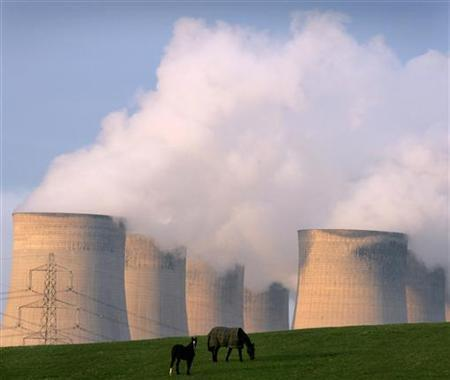 Horses graze near Ratcliffe on Solar power station in central England, December 8, 2004. Global warming is such a threat to security that military planners must build it into their calculations, the head of the armed forces said on Monday. REUTERS/Darren Staples