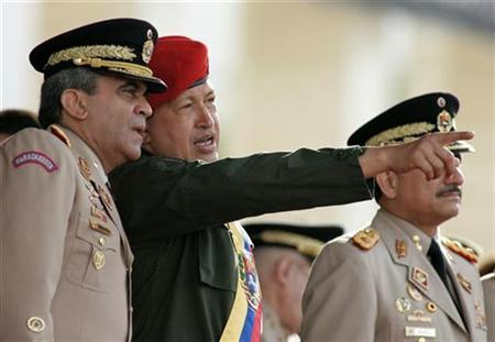 Venezuela's President Hugo Chavez (C) talks with his Defense Minister Raul Baduel (L) during a ceremony to celebrate the 186th anniversary of the army in Caracas, June 24, 2007. REUTERS/Francesco Spotorno