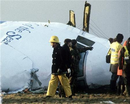 A December 23, 1988 file photo shows Scottish rescue workers and crash investigators search the area around the cockpit of Pan Am flight 103 in a farmer's field east of Lockerbie, Scotland. A Libyan man convicted of the 1988 Lockerbie plane bombing will find out on Thursday if he can appeal, potentially throwing the case wide open after nearly two decades. REUTERS/Greg Bos