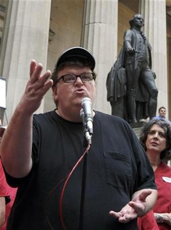 Filmmaker Michael Moore speaks to the media on Wall Street in New York, June 28, 2007. REUTERS/Brendan McDermid