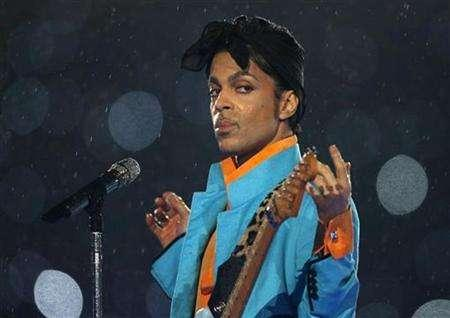 Prince performs during the halftime show of the NFL's Super Bowl XLI football game between the Chicago Bears and the Indianapolis Colts in Miami, Florida, in this file photo from February 4, 2007. Prince is to give away his new album for free with a British tabloid newspaper before its official launch, in a move that has caused dismay among music retailers. REUTERS/Mike Blake