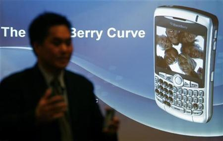 Norm Lee, vice president of Research in Motion (RIM), poses with the new ''Blackberry Curve 8300'' phone during its launch in Mumbai, in this file photo from June 22, 2007. Research In Motion has won permission to sell its BlackBerry device in China after eight years of effort, the Globe and Mail newspaper said on Wednesday. REUTERS/ Punit Paranjpe
