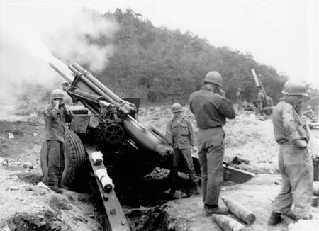 A gun crew from the 24th U.S. Infantry Division fires a 155-mm howitzer at positions in the Kojongchon sector, eight miles above the 38th Parallel, during the Korean War in a June 1951 photo. U.S. strategists are exploring how to implement a peace accord to officially end the 1950-53 Korean War and hope to start discussions with North Korea as soon as year end, The Wall Street Journal reported on Monday. REUTERS/U.S. Army/Handout