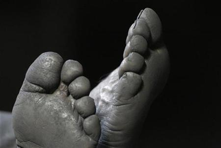 A miner rests his feet in China a file photo. German police broke into a darkened apartment fearing they would find a dead body, after neighbors complained of a nasty smell seeping out onto the staircase. REUTERS/Stringer