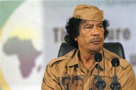 Libyan leader Muammar Gaddafi speaks at the University of Ghana in Accra June 30, 2007. U.S. President George W. Bush has written Libyan leader Muammar Gaddafi saying Washington wants to strengthen ties with Libya, Libyan news agency Jana reported. REUTERS/Luc Gnago