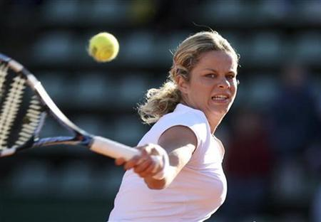 Kim Clijsters of Belgium returns the ball to Julia Vakulenko of Ukraine during their second round match of the J&S Cup tennis tournament in Warsaw May 3, 2007. Former tennis world number one and sporting media darling Kim Clijsters is pregnant with her first child, Belgian sports Web site www.sport.be reported on Tuesday, citing her father. REUTERS/Peter Andrews