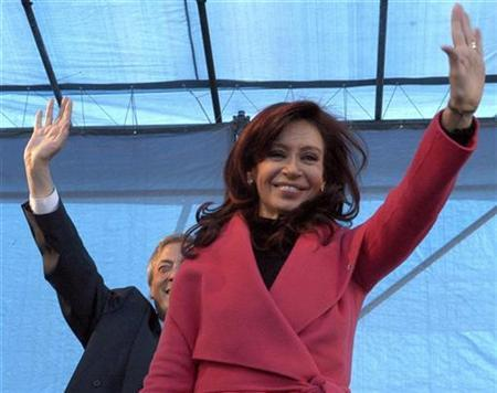 Argentina's First Lady Senator Crisitina Fernandez de Kirchner waves to well-wishers in front of her husband Argentine President Nestor Kirchner in this file photo taken in Buenos Aires in this May 22, 2007 file photo. Kirchner is the overwhelming favourite to win October's presidential election, but a series of corruption scandals and an energy crisis dogging President Nestor Kirchner could affect her campaign. REUTERS/Handout-Presidency