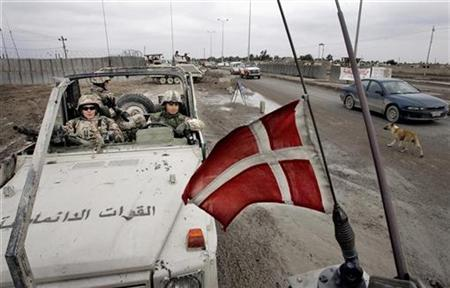Danish troops patrol in southern Iraq in this January 2005 file photo. Denmark said on Friday it secretly airlifted out of Iraq about 200 translators and other Iraqi employees of its troops in Iraq and their relatives this week and most were expected to seek asylum in the Nordic nation. REUTERS/Henning Bagger/Scanpix