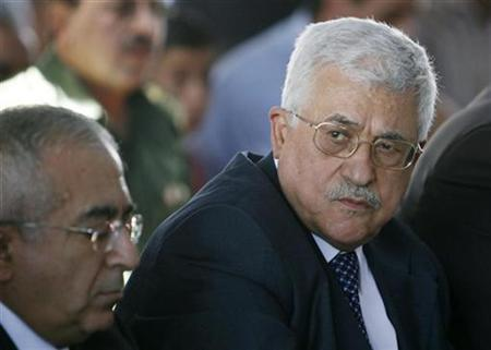 In this file photo, Palestinian President Mahmoud Abbas (R) and Salam Fayyad, whom Abbas named prime minister to replace Hamas's Ismail Haniyeh, attend Friday prayers in the West Bank city of Ramallah July 20, 2007. New Palestinian parliamentary and presidential elections could be organized in less than 90 days but may not be possible any time soon without Hamas's consent, officials involved in election planning said Saturday. REUTERS/Loay Abu Haykel