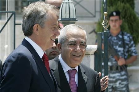 Salam Fayyad (R), whom Palestinian President Mahmoud Abbas named prime minister to replace Hamas' Ismail Haniyeh, greets Tony Blair, in the West Bank city of Ramallah, July 24, 2007. REUTERS/Loay Abu Haykel
