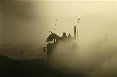 U.S. soldiers patrol through a dusty road near the town of Ghazni, southeastern Afghanistan, April 23, 2007. U.S.-led troops, backed by air power, killed more than 50 insurgents in a battle in Afghanistan's southern province of Helmand, the U.S. military said on Thursday. REUTERS/Goran Tomasevic