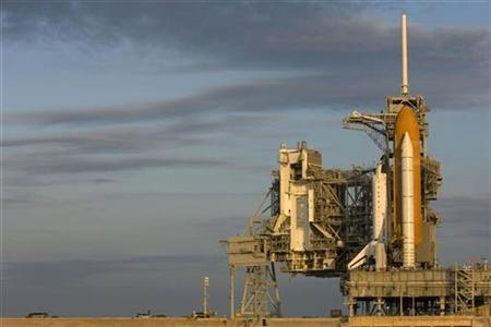 Space shuttle Endeavour sits on launch pad 39A after rolling out of the Vehicle Assembly Building at Kennedy Space Center in Cape Canaveral, Florida July 11, 2007. A panel has found that astronauts were allowed to fly on at least two occasions despite warnings they were so drunk they posed a flight risk, Aviation Week reported on Thursday on its Web site. REUTERS/Scott Audette